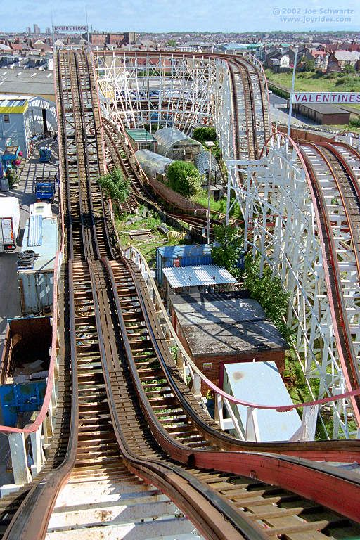 two coasters leave at the same time and race to the finish. Grand National roller coaster at Blackpool Pleasure Beach