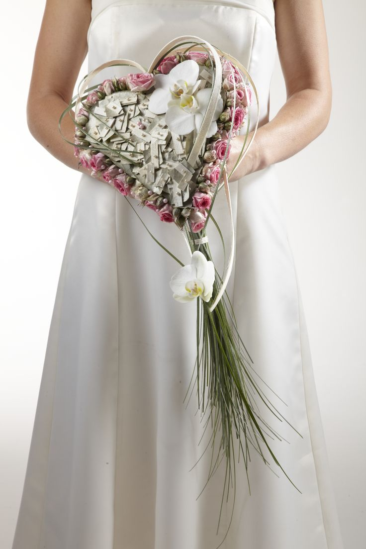 OASIS® Lady Heart Bouquet Holder with Pink Spray Roses, White Phalaenopsis Orchid and Grasses create this unique heart shaped Bridal Wedding Bouquet. www.oasisfloral.com