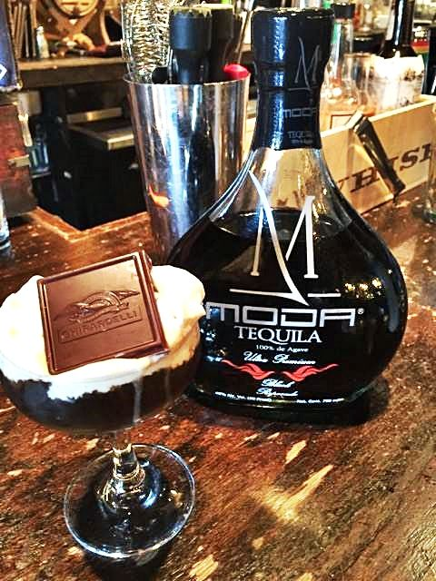 """Get ready for the weekend with one of our new signature drinks - The MODA """"Black Friday""""! Directions: 1/2 OZ MODA Black Reposado 1/4 OZ Godiva Dark Chocolate Liquer 1/4 OZ Frangelico Hazelnut Liqueur 1/4 OZ Kalhúa Coffee Liqueur 3/4 OZ Lime Juice  Topped with Cream alcoholic whipped cream and a garnished with Godiva Dark Chocolate."""