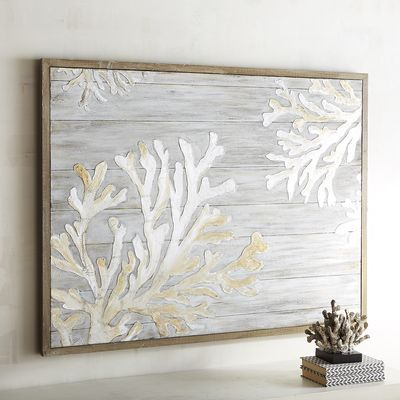 No matter how far you may live from the sea, you can always bring a bit of it home with you. Create a coastal vibe as far inland as you'd like with whitewashed coral carved atop a plank-like backdrop. The ocean is only as far as you imagine it.