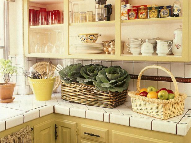 Making Small Kitchens Look Bigger: Tiny kitchens can feel claustrophobic when cabinets are towering overhead.  Get organized and trade the top cupboards for open storage. Consider shelving, pot racks and magnetic knife or spice holders instead. Your kitchen will look more spacious and serve up display space for your favorite dishes, shiny pots and pans, or artwork.
