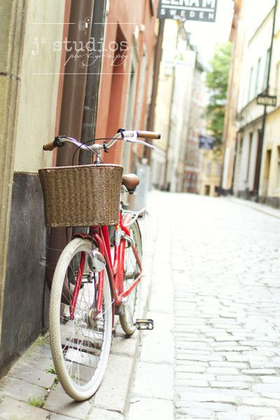 bicycle art print red bike brown basket photograph stockholm sweden scandinavia old town gamla stan j2studios larry jang feminine photography cobblestone street