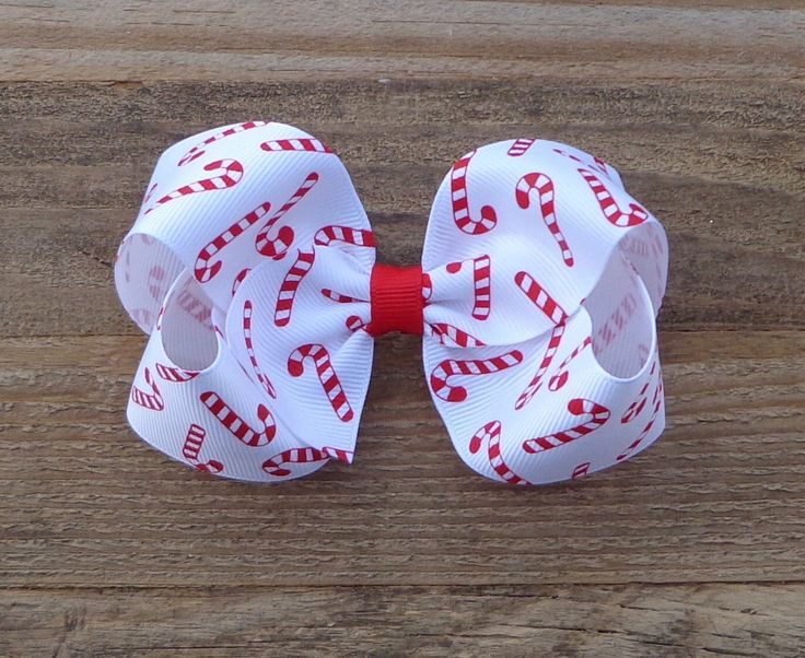 Christmas Boutique Bow~Candy Cane Hair Bow~Holiday Hair Bow~Red/White Christmas Hair Bow~Holiday Bow~Medium/Large Hair Bow~Boutique Bow~ by LizzyBugsBowtique on Etsy https://www.etsy.com/listing/555121894/christmas-boutique-bowcandy-cane-hair