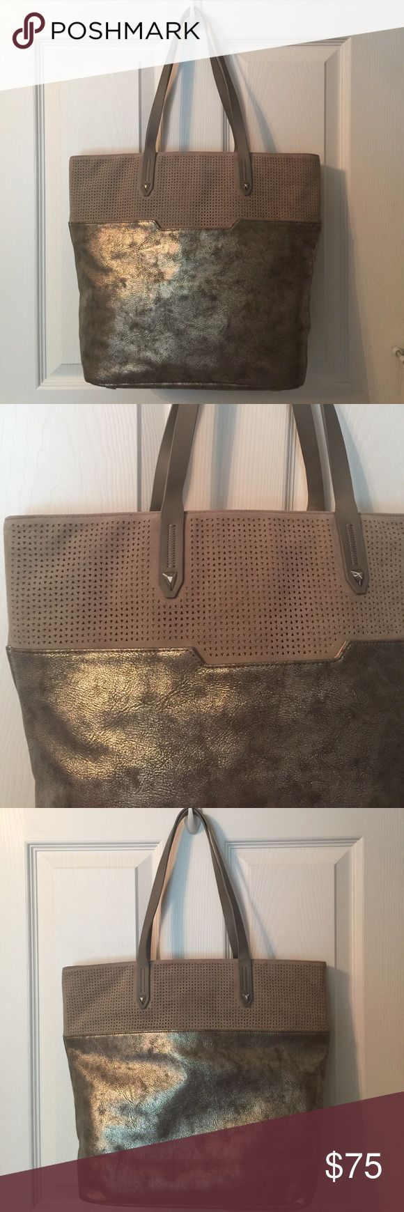 Stella & Dot Metallic Tote This gently used tote is great for everyday use and has multiple pockets inside along with an outside pocket. Mixed of surfed perf and distressed metallic vegan leather. Signs of wear (see last pic) Stella & Dot Bags Totes