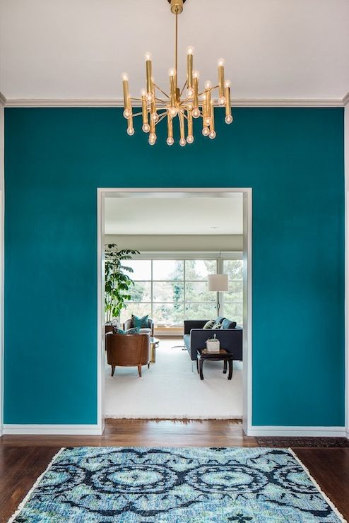 Cheryl Burke Interior Design: Incredible foyer with teal wall color and hardwood floors layered with a blue ikat wool ... Benjamin Moore color galapagos turquois