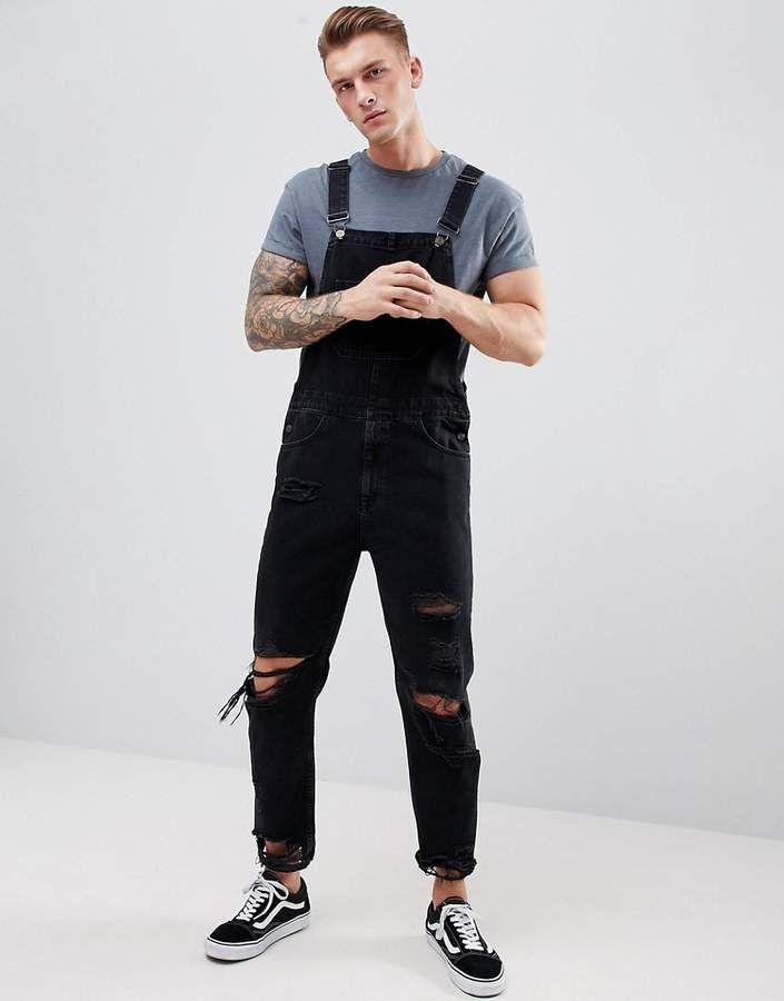 6813c02ada72e ASOS DESIGN skinny denim overalls in black with heavy rips
