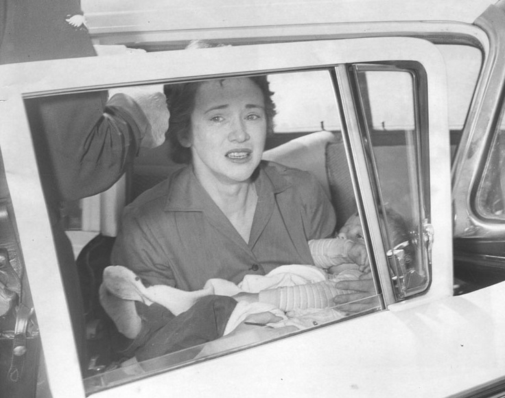 """Photograph caption dated November 26, 1959 reads, """"Feared Baby Was Dead -- Mrs. Constance Gabler, 32, of North Hollywood, holds her tiny son Grant close to her after discovering he still was alive after falling out of her car as she turned onto the Hollywood freeway."""""""