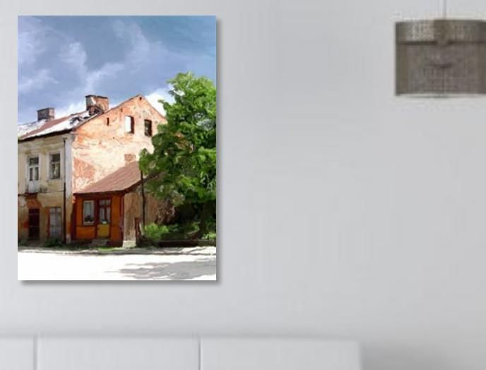 This picture on my wall was made from one of series of photos I took around the main market square in a small town in eastern Poland about a decade ago. The contrast of different periods and the decay were interesting.