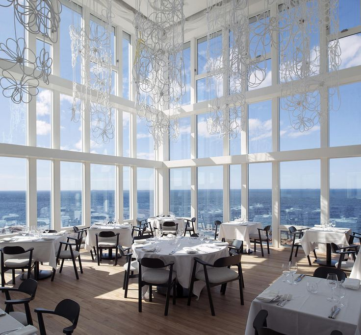 The dining room offers unparalleled vistas through floor-to-ceiling windows of sunsets, storms, and the iceberg-littered Atlantic.