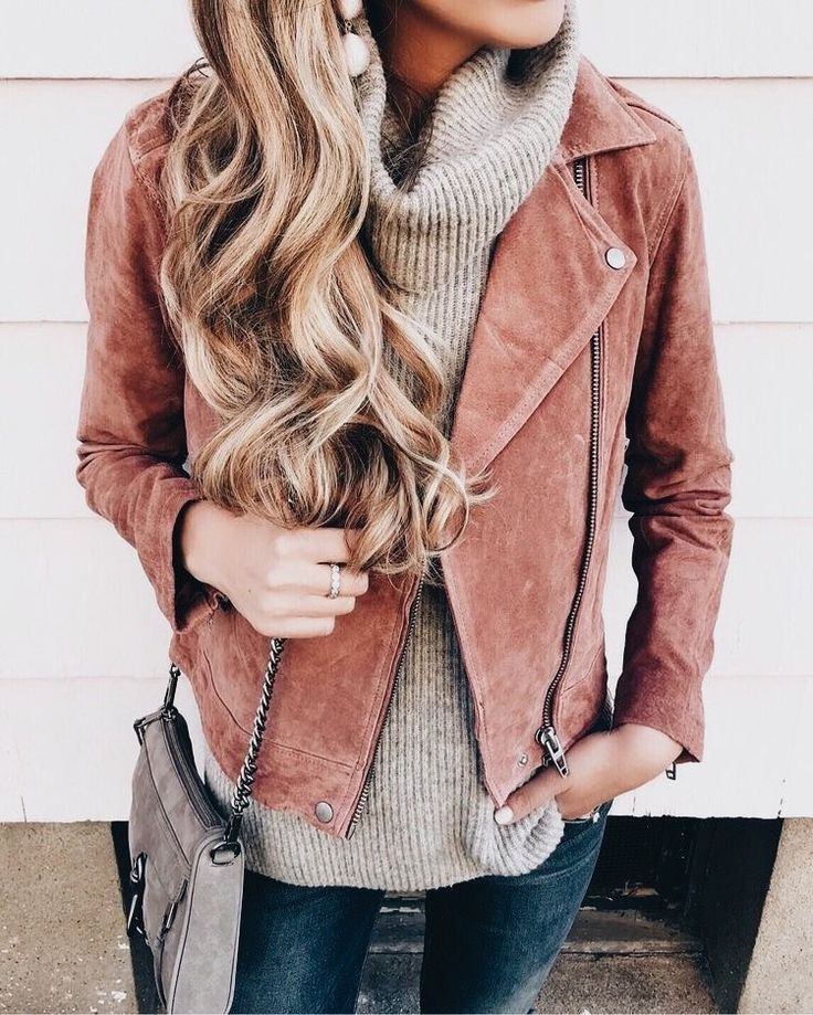 Cute suede coral jacket over taupe cowl neck sweater and blue jeans.