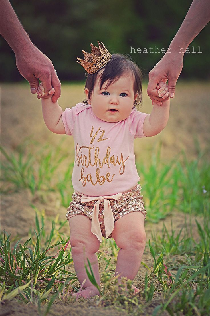 1/2 Birthday Babe™ Short Sleeve Baby Bodysuit with gold sparkle. This listing is only for the bodysuit. Bodysuit available in black, pink or white with gold sparkle design. Short Sleeve Baby bodysuit.