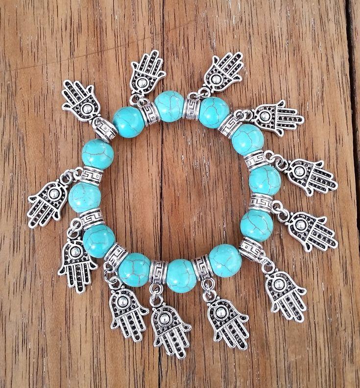 PULSEIRA TURQUESA BOHO CHIC HAMSA - silicone <br>Linda pulseira com Pedras Turquesa,, com destaque nos pingentes de Hamsa em metal prateado.