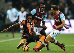 Hull City's Dieumerci Mbokani battles for the ball with Hammer Michail Antonio and goalscorer Mark Noble.