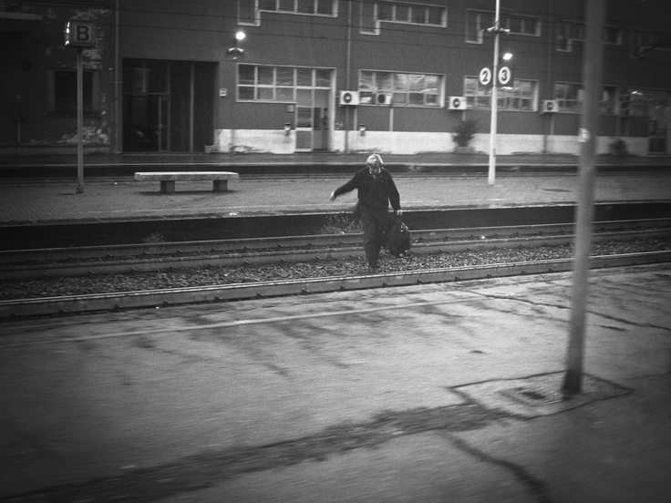 Man running across rails trying not to miss the train i was on.
