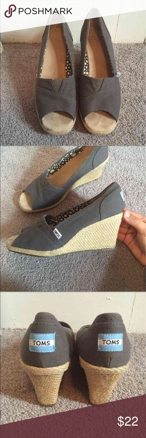 Gray TOMS peeptoe wedges sz 10 Women's gray canvas espadrille TOMS wedges. These are super cute and comfortable! Can be easily dressed up or down. Only flaws are the little spot in the front seen on the bottom left of first pic, and a strange orange line on the right shoe seen in the last pic. Both of these are discreet when they are being worn and could probably be removed! The shoes themselves are in great condition otherwise and weren't worn too much. :) Toms Shoes Wedges