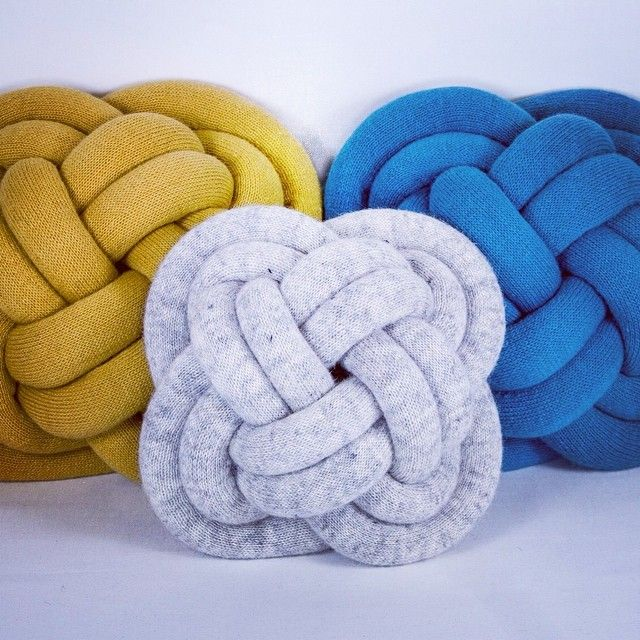 Genius way to turn tubular knit limbs into lovely knot cushions.