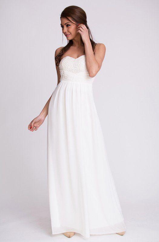 Biała, elegancka długa suknia ozdobiona koralikami I cekinami. #suknia #sukienka #elegancka #biała #długa #kobieta #moda #trendy