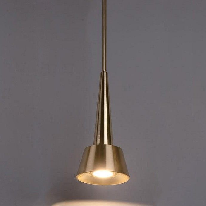 Brushed brass and a sleek, retro style makes the Rocket dweLED Pendant Light a knock out of a light.