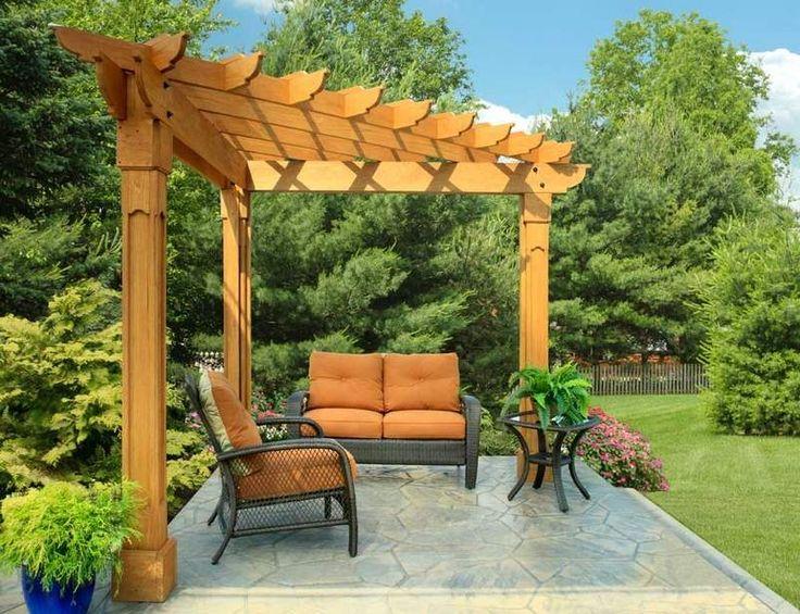 pergola d'angle avec toiture trinagulaire pour la terrasse de jardin en dalles
