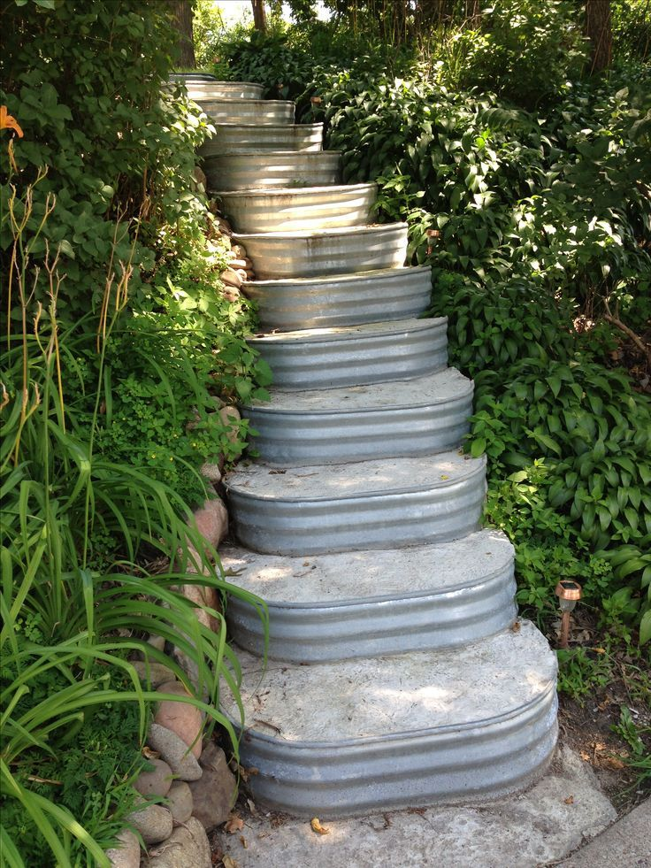 Unique outdoor stairs made of cement-filled window wells.