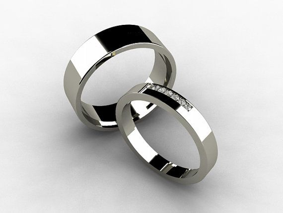 Wedding band set with women's thin diamond band and men's simple titanium band by TorkkeliJewellery, $887.00