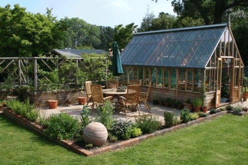 I'm liking the privacy fence/trellis and herb bed with this greenhouse and patio