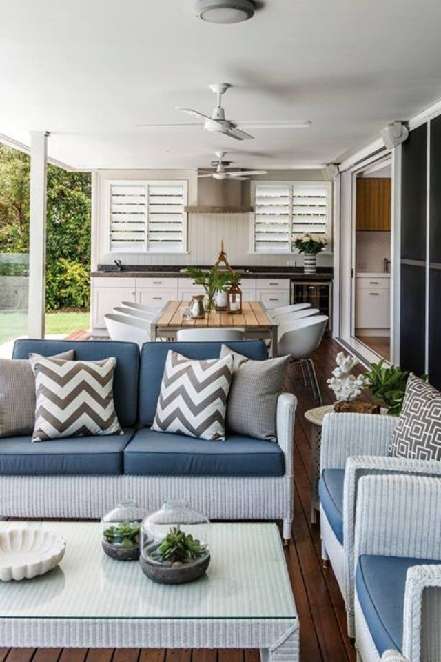 From Queensland Homes Magazine. Indoor outdoor living area. Sliding doors on to deck. Outdoor lounge and kitchen.