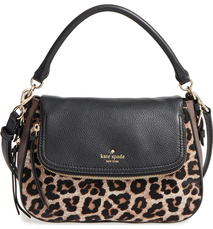 Gleaming hardware and a bold leopard print add a fierce touch to this compact pebbled-leather crossbody bag by Kate Spade that's practical as well as beautiful.