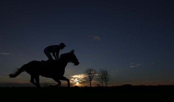 A runner makes its way to the start for the last race of the day as the sun begins to set at Wincanton racecourse on January 15, 2015 in Wincanton, England. (January 14, 2015 - Source: Alan Crowhurst/Getty Images Europe)