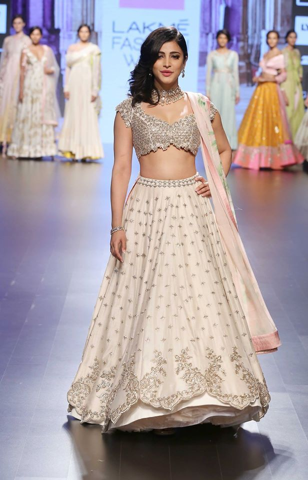 Shruti Hasan in ivory lehenga with scalloped handmade zardozi and floral pastel lily print dupatta by Anushree Reddy at Lakme Fashion Week Summer Resort 2016 front view