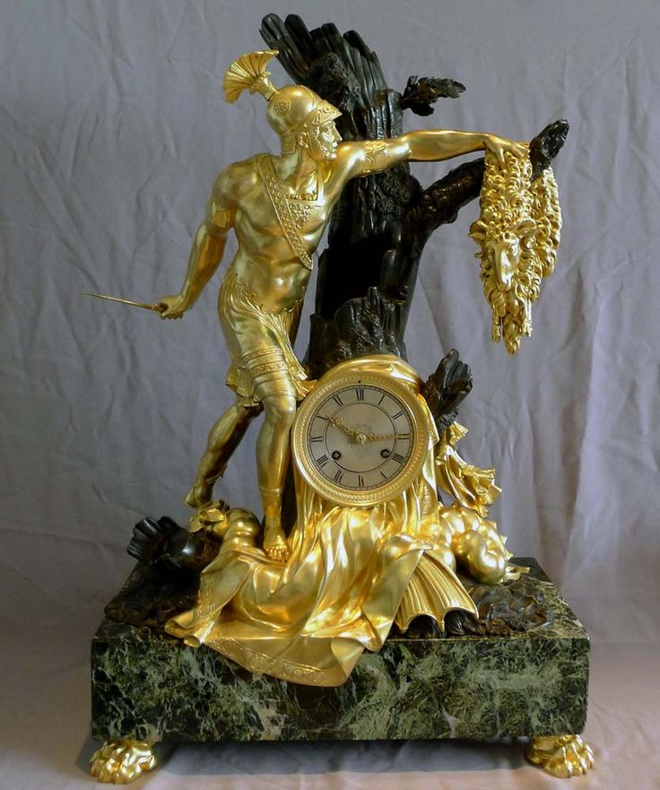 Antique and magnificent French Charles X clock of Jason and the Golden Fleece in patinated bronze, ormolu and antique vert marble. This is an interpretation of one aspect the well known Greek myth of Jason and the Argonauts. Here he slays the dragon protecting the Golden Fleece. Jason has full armour with sword in hand reaching out for the fleece on the tree branch and standing on the body of the dragon. Massive marble base and set on four large paw feet. The movement is dated 1828.