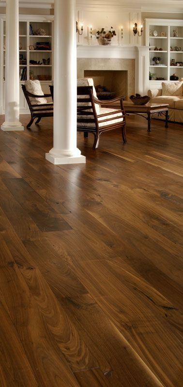 Walnut wide plank wood floors -- Casey says hard wood through out.. I say.. your the man, who am I to argue with that.. horrible.. horrible idea ;)