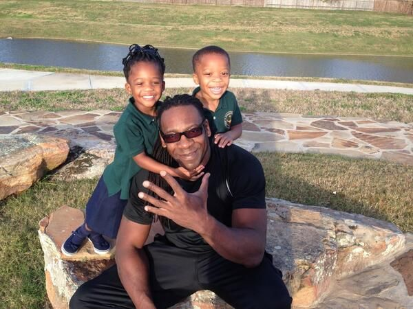 WWE Hall of Fame Superstar Booker T with his adorable twins, Kindrick & Kennedy Huffman. Their mother is Booker T's wife, Sharmell Sullivan-Huffman (former WWE Diva Queen Sharmell) #WWE #WWEFamilies #Fatherhood