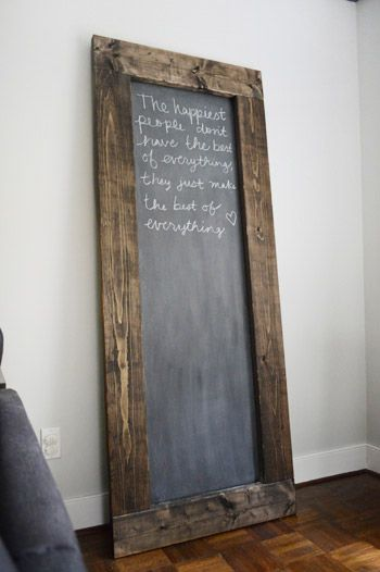 Great rustic wood framed chalk board - Young House Love.  also includes pics on how to attach to wall to keep our kiddo's safe  :)