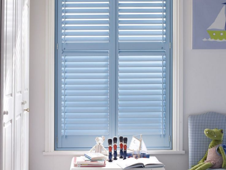Pale 'baby' blue shutters in a children's nursery room