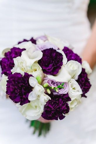 This purple is very strong and yet I'm drawn to it. Maybe an option for bridesmaids? Something like this against green dresses instead of lavender dresses?