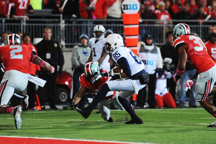BRANDON FELDER fights way into end zone with 12-yard pass from Hackenberg for first Penn State touchdown, as Jesse James signals score.