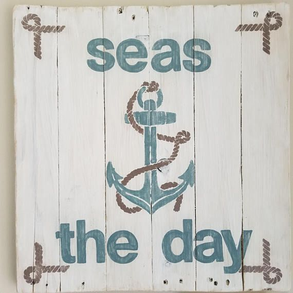 Anchor Wall Art - Seas the Day (appx. 19x20) This beautiful sign is made from reclaimed pallet wood and is perfect for any beach or nautical inspired decor! Painted in shades of bluish gray and brown. Sealed with matte finish spray. Ready to hang. Weighs appx. 4.5 lbs. This unique