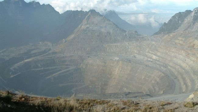 Grasberg Mine, Indonesia.  Surrounded by mountains and glaciers in Papua, the U.S.-owned Freeport Grasberg mine is believed to hold one of the world's largest copper reserves and its largest gold reserves, inside its network of both open-put and underground tunnels and mines.