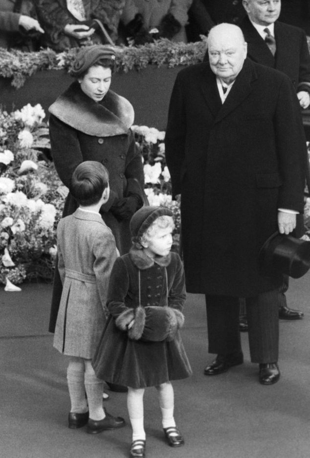 FILE - In this Nov. 24, 1954 file photo, Elizabeth II of England and Prime Minister, Sir Winston Churchill, wait at Waterloo station for the Queen mother on ...