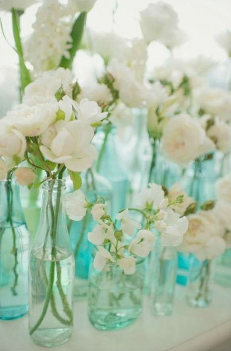 Love the white flowers with the old glass...so simple and easy.