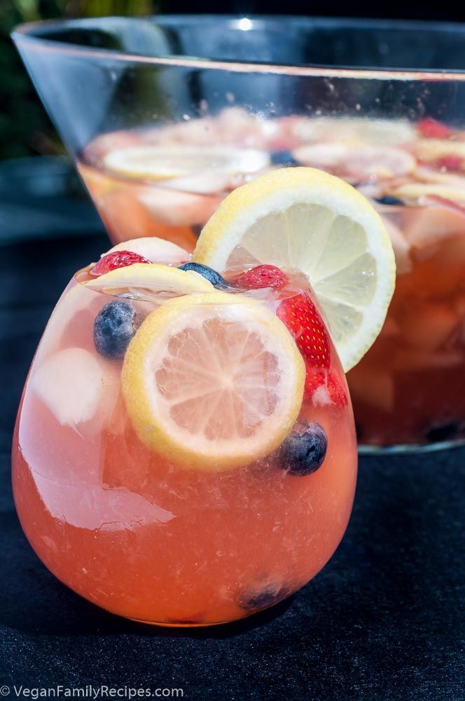 White Peach Sangria Recipe with White Wine, Blueberries, and Strawberries.