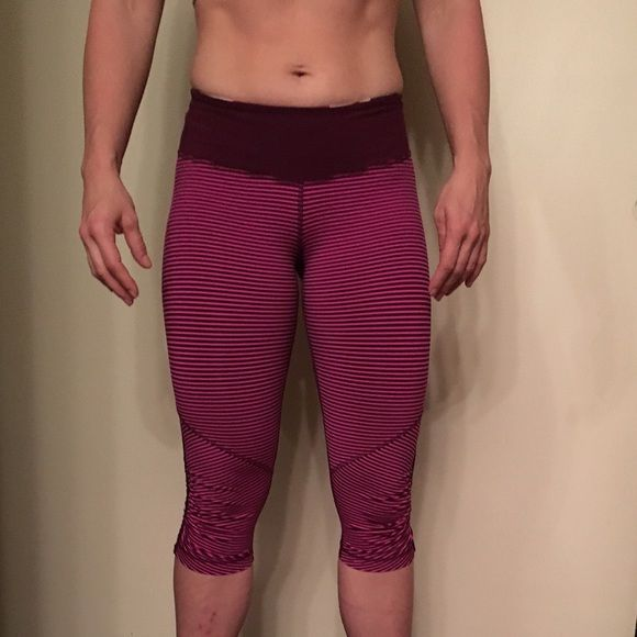 Lululemon runners crop. Lululemon maroon and bright pink runners crop. Mesh behind the knee for breathing. Excellent condition no stains or flaws lightly worn. lululemon athletica Pants Track Pants & Joggers