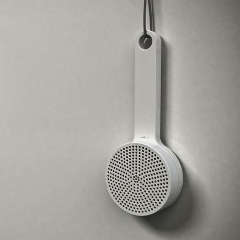 neat shower radio concept by designer gerhardt kellermann, inspired by the muji wooden brush and using the speaker as a volume control.