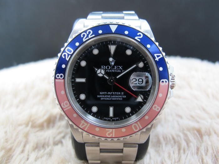 Catawiki online auction house: 1999 ROLEX GMT MASTER 16710 PEPSI RED/BLUE BEZEL