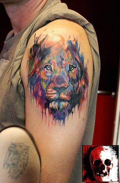 Watercolor lion head tattoo