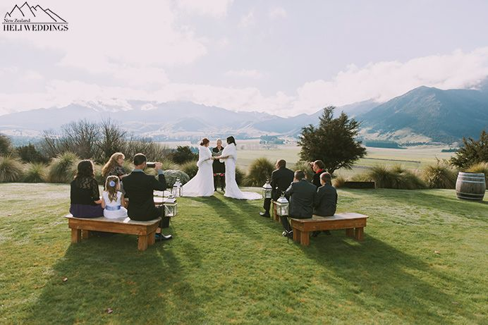 same sex wedding Brides exchanging vows at Look out lodge, Intimate elopement  Wanaka, New Zealand
