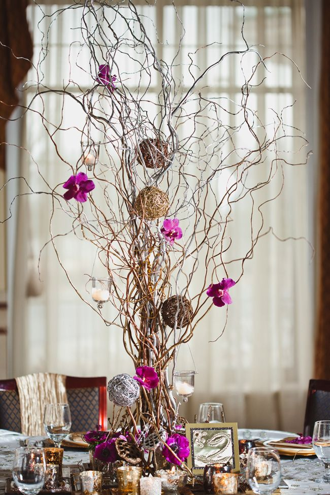 Curly Willow Natural branches centerpiece - some spray painted silver with twig balls and orchids.