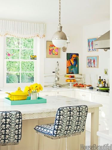 All white kitchen with pops of art