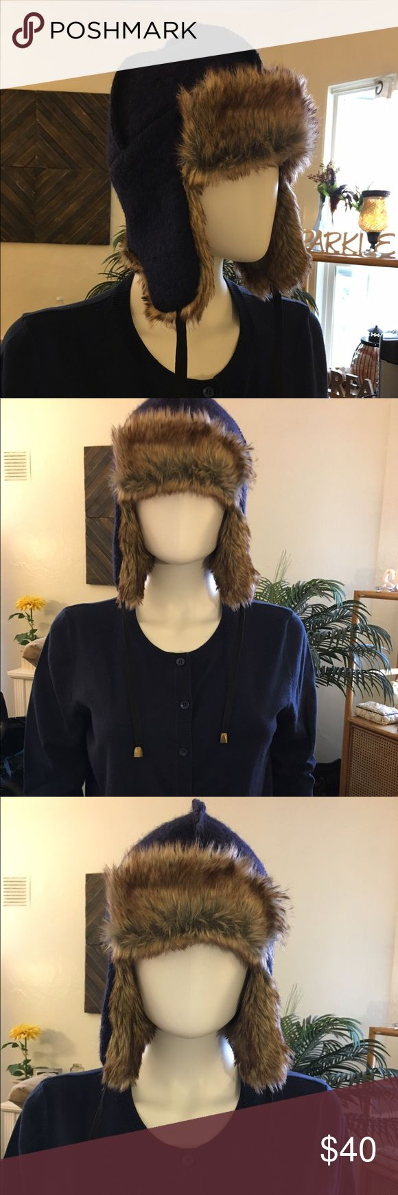 Urban Outfitters Navy Blue Fur-lined Trapper Hat 💙This is a Navy Blue fur-lined trapper hat from Urban Outfitters. The fur is inside the entire interior of the hat. There are two strings with a metal bead that comes down from each side of the hat. So cute! 💙 BDG Accessories Hats